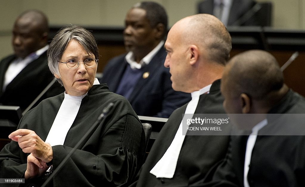 Prosecutor Brenda J. Hollis talks to colleagues in the courtroom prior to the appeal judgement of Former Liberia's President Charles Ghankay Taylor in The Hague on September 26, 2013. The appeals judges' ruling at the Special Court for Sierra Leone (SCSL) marks the end of the road for the former west African strongman's seven-year long trial. AFP PHOTO / POOL / KOEN VAN WEEL