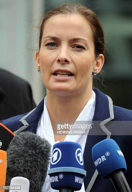 Prosecutor Britta Zur answers journalists' questions in front of the jobcenter in Neuss western Germany on September 26 where a 52year old man had...