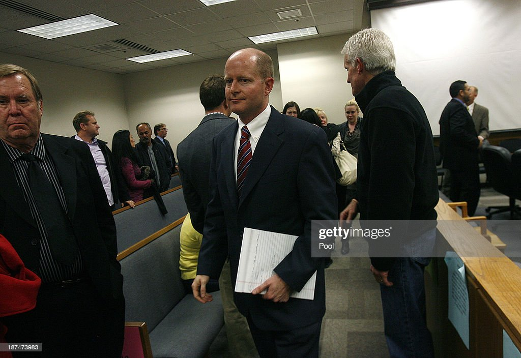 Prosecutor Chad Grunander leaves the court room after Martin McNeill was found guilty by the jury for the murder of his wife Michele MacNeill on November 9, 2013 in Provo, Utah. Martin MacNeill, was found guilty of murdering his wife Michele MacNeill in 2007 to continue an affair with a younger woman.