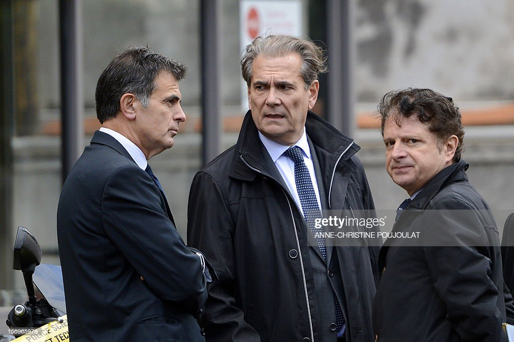 Prosecutor Jacques Dallest, Police Prefect of the Bouches-du-Rhone, Jean-Paul Bonnetain and the public security chairman, Pierre-Marie Bourniquel talk near a crime scene on November 26, 2012 in Marseille, southeastern France, in front of a cigar store where a 47-year old man was shot dead by two unidentified people who stole his briefcase. AFP PHOTO / ANNE-CHRISTINE POUJOULAT