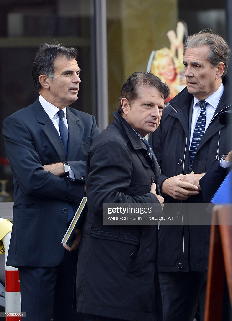Prosecutor Jacques Dallest (L) talks to the Police Prefect of the Bouches-du-Rhone, Jean-Paul Bonnetain (R) beside the public security chairman, Pierre-Marie Bourniquel (C) near a crime scene on November 26, 2012 in Marseille, southeastern France, in front of a cigar store where a 47-year old man was shot dead by two unidentified people who stole his briefcase. AFP PHOTO / ANNE-CHRISTINE POUJOULAT