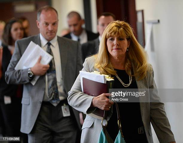 Prosecutor Karen Pearson right leads her team out of a status hearing in the James Holmes case at the Arapahoe County Justice Center Tuesday morning...