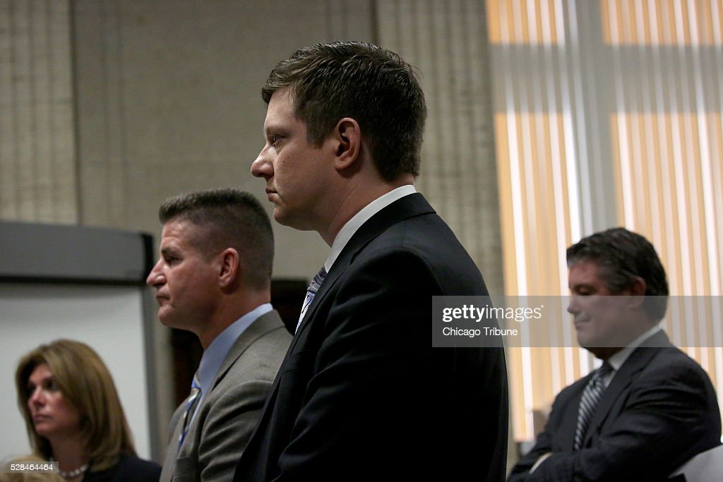 Prosecutor Lynn McCarthy, from left, defense attorney Dan Herbert, Jason Van Dyke and defense attorney Randy Rueckert stand before Judge Vincent Gaughan at the Leighton Criminal Court Building in Chicago on Thursday, May 5, 2016.