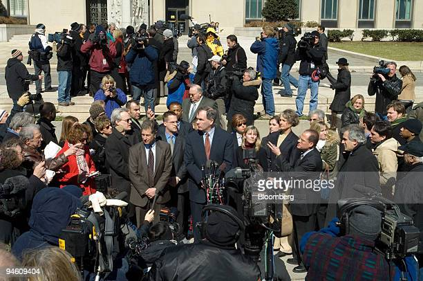 Prosecutor Patrick Fitzgerald center US attorney in Chicago surrounded by members of his team delivers a statement on the guilty verdict handed down...