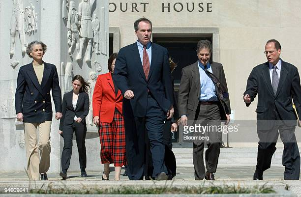 Prosecutor Patrick Fitzgerald center US attorney in Chicago walks with members of his team outside the federal courthouse in Washington DC to deliver...