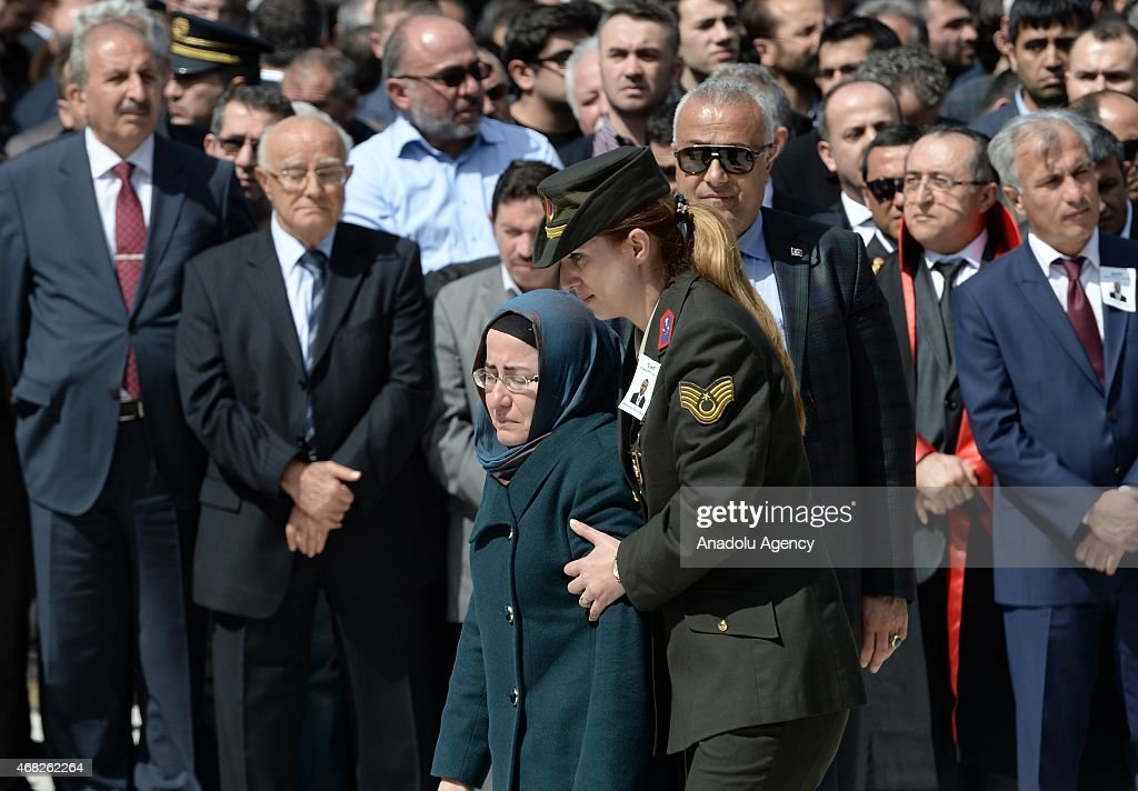 Prosecutor's wife Yasemin Kiraz mourns during the funeral ceremony of Turkish prosecutor Mehmet Selim Kiraz who was shot and critically wounded in an...