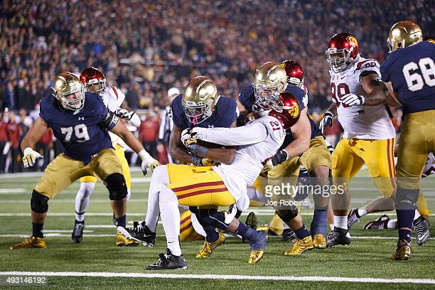 J Prosise of the Notre Dame Fighting Irish plows into the end zone with a sixyard touchdown run against the USC Trojans in the fourth quarter of the...
