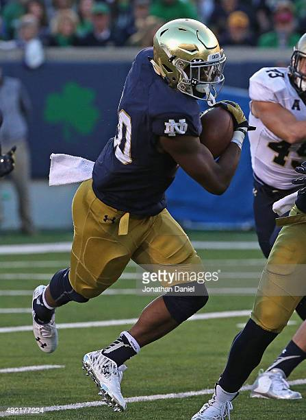 J Prosise of the Notre Dame Fighting Irish runs for a first down against the Navy Midshipmen at Notre Dame Stadium on October 10 2015 in South Bend...