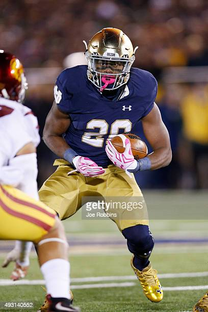 J Prosise of the Notre Dame Fighting Irish runs the ball against the USC Trojans in the first half of the game at Notre Dame Stadium on October 17...