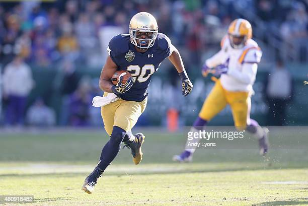 J Prosise of the Notre Dame Fighting Irish runs with the ball against the LSU Tigers during the Franklin American Mortgage Music City Bowl at LP...