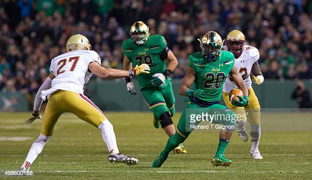 J Prosise of the Notre Dame Fighting Irish runs with the ball against Justin Simmons of the Boston College Eagles at Fenway Park during the 'Shamrock...