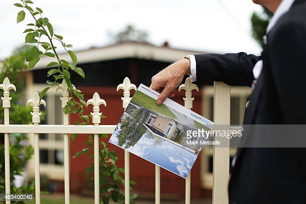 A prospective buyer looks at a property before the home auction for a fourbedroom house at 230 Blacktown Road on February 14 2015 in Blacktown...