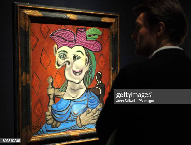 A prospective buyer studies the painting by Pablo Picasso titled Dora Maar which is valued at 4/8million and is one of several masterpieces that will...