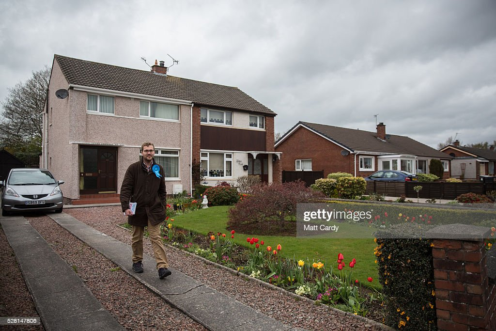 Prospective Conservative MSP for Dumfriesshire Oliver Mundell canvasses on the streets of a housing estate on May 4, 2016 in Dumfries, Scotland. The son of David Mundell, the Secretary of State for Scotland and the only Tory MP in Scotland, is hoping that disgruntled Labour voters and a swing to the Conservatives in the constituency he is campaigning in will lead to him taking a place in Holyrood in tomorrow's Scottish Parliament elections. As campaigning for the Holyrood election enters its last twenty four hours, recent polls suggest the Conservatives are virtually neck-and-neck with Labour in the race to be the main opposition party in Scotland.