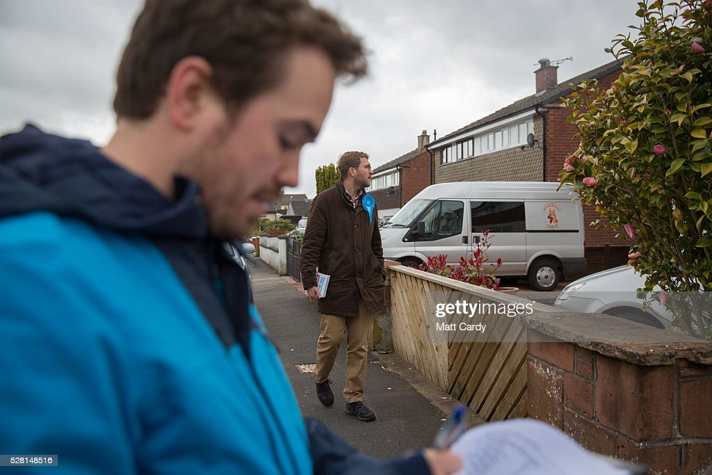 Prospective Conservative MSP for Dumfriesshire Oliver Mundell (R) canvasses on the streets of a housing estate on May 4, 2016 in Dumfries, Scotland. The son of David Mundell, the Secretary of State for Scotland and the only Tory MP in Scotland, is hoping that disgruntled Labour voters and a swing to the Conservatives in the constituency he is campaigning in will lead to him taking a place in Holyrood in tomorrow's Scottish Parliament elections. As campaigning for the Holyrood election enters its last twenty four hours, recent polls suggest the Conservatives are virtually neck-and-neck with Labour in the race to be the main opposition party in Scotland.