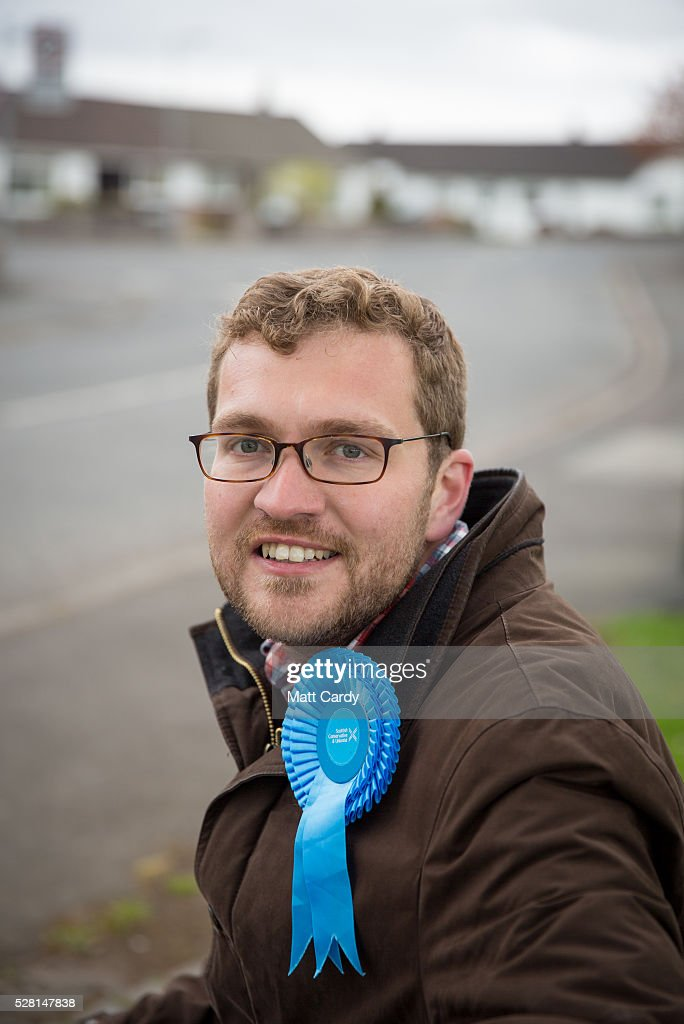Prospective Conservative MSP for Dumfriesshire Oliver Mundell poses for a photograph as he canvasses on the streets of a housing estate on May 4, 2016 in Dumfries, Scotland. The son of David Mundell, the Secretary of State for Scotland and the only Tory MP in Scotland, is hoping that disgruntled Labour voters and a swing to the Conservatives in the constituency he is campaigning in will lead to him taking a place in Holyrood in tomorrow's Scottish Parliament elections. As campaigning for the Holyrood election enters its last twenty four hours, recent polls suggest the Conservatives are virtually neck-and-neck with Labour in the race to be the main opposition party in Scotland.