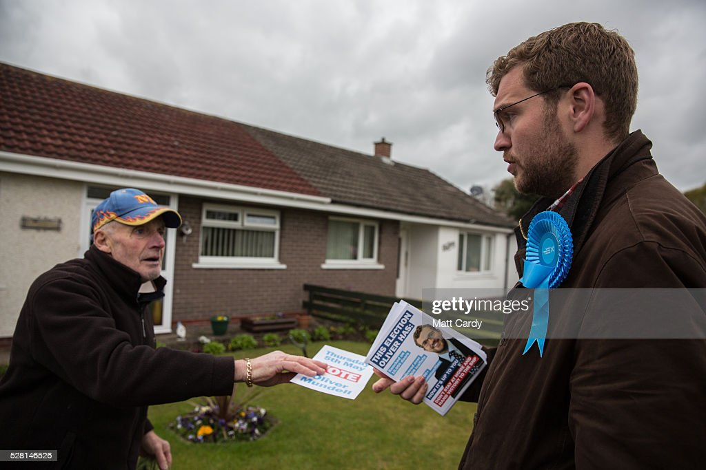 Prospective Conservative MSP for Dumfriesshire Oliver Mundell speaks with potential voters as he canvasses on the streets of a housing estate on May 4, 2016 in Dumfries, Scotland. The son of David Mundell, the Secretary of State for Scotland and the only Tory MP in Scotland, is hoping that disgruntled Labour voters and a swing to the Conservatives in the constituency he is campaigning in will lead to him taking a place in Holyrood in tomorrow's Scottish Parliament elections. As campaigning for the Holyrood election enters its last twenty four hours, recent polls suggest the Conservatives are virtually neck-and-neck with Labour in the race to be the main opposition party in Scotland.