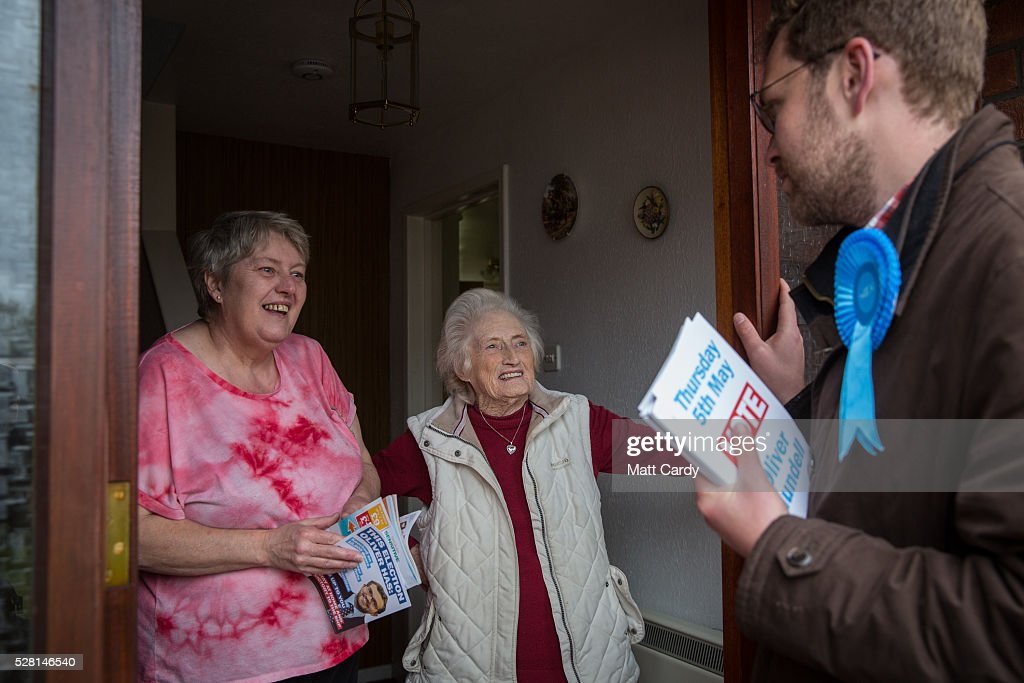 Prospective Conservative MSP for Dumfriesshire Oliver Mundell speaks with voters as he canvasses on the doorstep of a housing estate on May 4, 2016 in Dumfries, Scotland. The son of David Mundell, the Secretary of State for Scotland and the only Tory MP in Scotland, is hoping that disgruntled Labour voters and a swing to the Conservatives in the constituency he is campaigning in will lead to him taking a place in Holyrood in tomorrow's Scottish Parliament elections. As campaigning for the Holyrood election enters its last twenty four hours, recent polls suggest the Conservatives are virtually neck-and-neck with Labour in the race to be the main opposition party in Scotland.