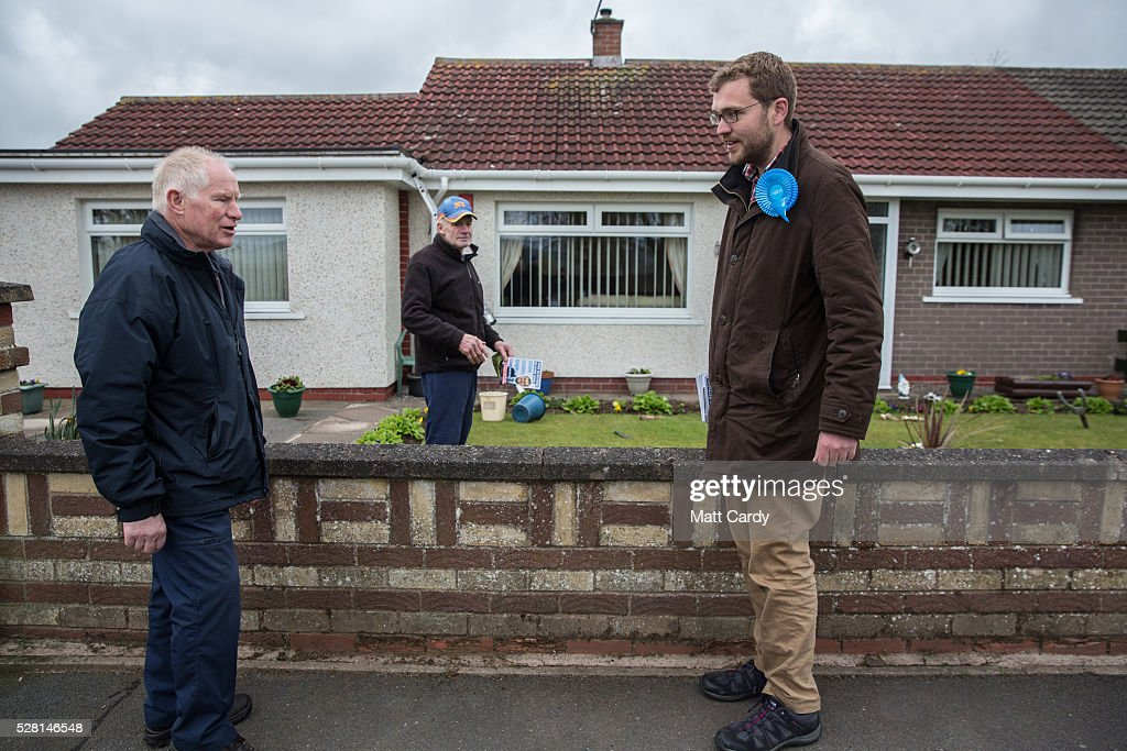 Prospective Conservative MSP for Dumfriesshire Oliver Mundell (R) speaks with potential voters as he canvasses on the streets of a housing estate on May 4, 2016 in Dumfries, Scotland. The son of David Mundell, the Secretary of State for Scotland and the only Tory MP in Scotland, is hoping that disgruntled Labour voters and a swing to the Conservatives in the constituency he is campaigning in will lead to him taking a place in Holyrood in tomorrow's Scottish Parliament elections. As campaigning for the Holyrood election enters its last twenty four hours, recent polls suggest the Conservatives are virtually neck-and-neck with Labour in the race to be the main opposition party in Scotland.