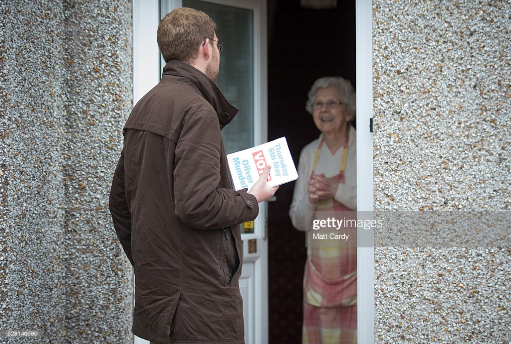 Prospective Conservative MSP for Dumfriesshire Oliver Mundell speaks with a potential voter as he canvasses on the doorstep of a housing estate on May 4, 2016 in Dumfries, Scotland. The son of David Mundell, the Secretary of State for Scotland and the only Tory MP in Scotland, is hoping that disgruntled Labour voters and a swing to the Conservatives in the constituency he is campaigning in will lead to him taking a place in Holyrood in tomorrow's Scottish Parliament elections. As campaigning for the Holyrood election enters its last twenty four hours, recent polls suggest the Conservatives are virtually neck-and-neck with Labour in the race to be the main opposition party in Scotland.
