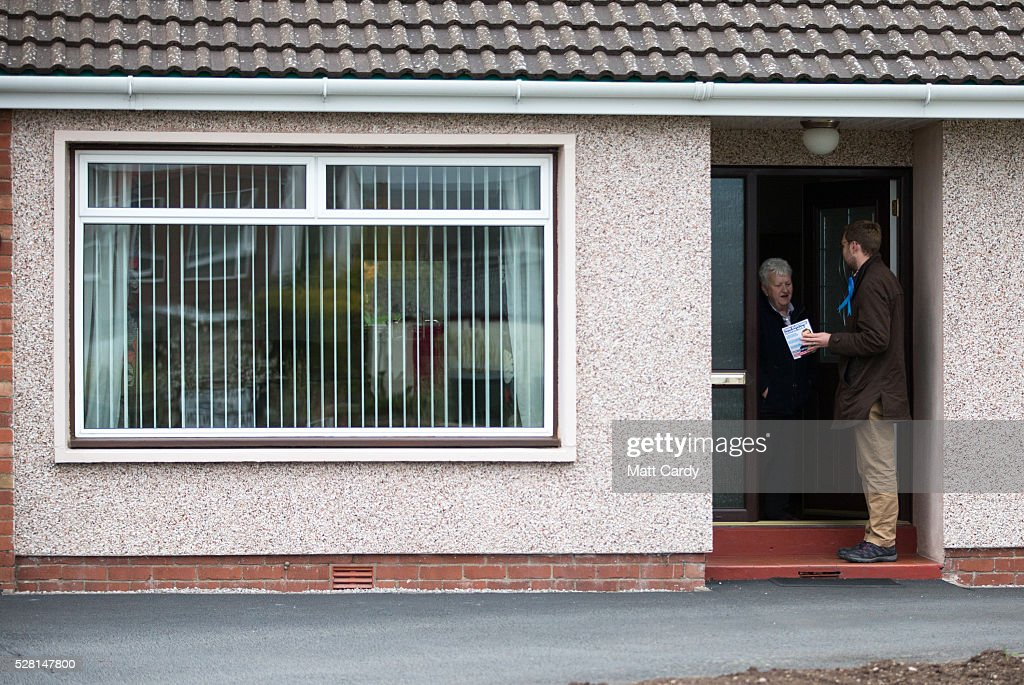 Prospective Conservative MSP for Dumfriesshire Oliver Mundell speaks with a potential voter as he canvasses on the streets of a housing estate on May 4, 2016 in Dumfries, Scotland. The son of David Mundell, the Secretary of State for Scotland and the only Tory MP in Scotland, is hoping that disgruntled Labour voters and a swing to the Conservatives in the constituency he is campaigning in will lead to him taking a place in Holyrood in tomorrow's Scottish Parliament elections. As campaigning for the Holyrood election enters its last twenty four hours, recent polls suggest the Conservatives are virtually neck-and-neck with Labour in the race to be the main opposition party in Scotland.