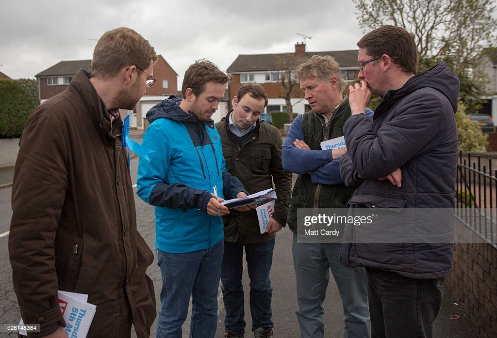 Prospective Conservative MSP for Dumfriesshire Oliver Mundell (L) talks with his campaign team as he canvasses on the street of a housing estate on May 4, 2016 in Dumfries, Scotland. The son of David Mundell, the Secretary of State for Scotland and the only Tory MP in Scotland, is hoping that disgruntled Labour voters and a swing to the Conservatives in the constituency he is campaigning in will lead to him taking a place in Holyrood in tomorrow's Scottish Parliament elections. As campaigning for the Holyrood election enters its last twenty four hours, recent polls suggest the Conservatives are virtually neck-and-neck with Labour in the race to be the main opposition party in Scotland.