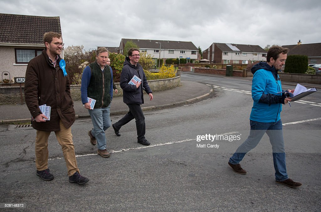 Prospective Conservative MSP for Dumfriesshire Oliver Mundell (L) walks with his campaign team as he canvasses on the street of a housing estate on May 4, 2016 in Dumfries, Scotland. The son of David Mundell, the Secretary of State for Scotland and the only Tory MP in Scotland, is hoping that disgruntled Labour voters and a swing to the Conservatives in the constituency he is campaigning in will lead to him taking a place in Holyrood in tomorrow's Scottish Parliament elections. As campaigning for the Holyrood election enters its last twenty four hours, recent polls suggest the Conservatives are virtually neck-and-neck with Labour in the race to be the main opposition party in Scotland.