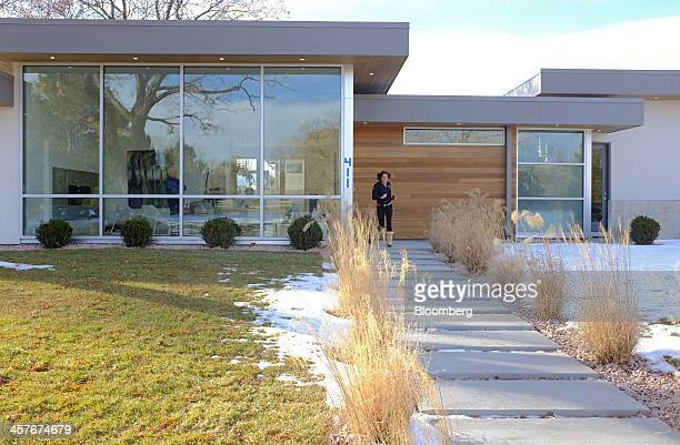 Prospective home buyer Valerie Van Lerberghe walks down the path of a new home for sale in Denver Colorado US on Friday Dec 13 2013 The Commerce...