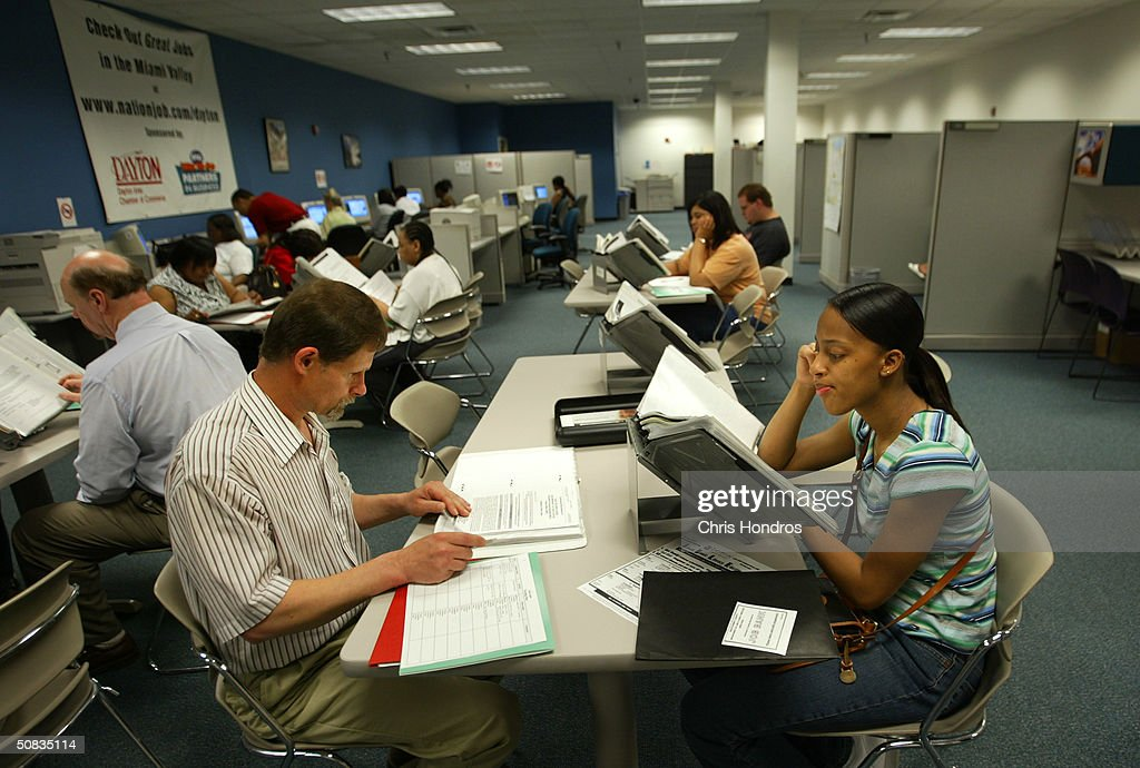 Prospective job applicants look for jobs in the job research area of The Job Center May 11 2004 in Dayton Ohio The Job Center is the largest...