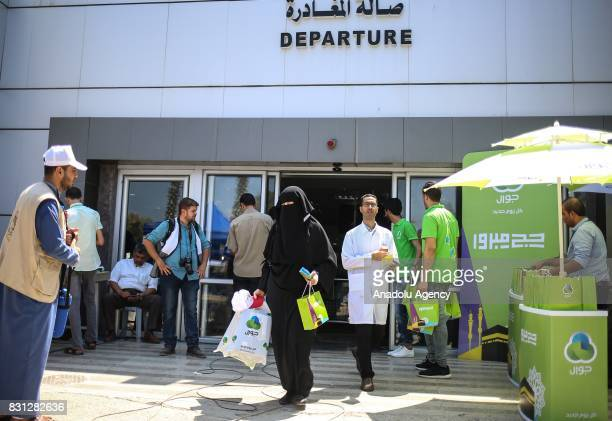 Prospective pilgrims wait to cross Rafah border crossing before moving forward to the Muslims' Holiest city of Mecca of Saudi Arabia for making a...