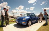 Prospective Volkswagen Beetle buyers view the 1998 model of the famous German vehicle 07 April in Norwalk California The new Beetle which can cost...