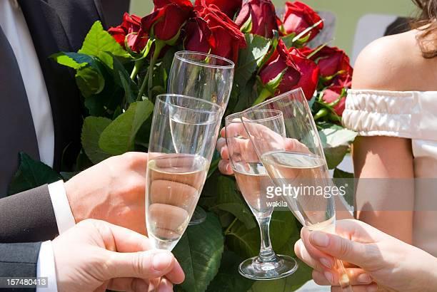 prost with glass on wedding marriage - Anstoßende Gäste