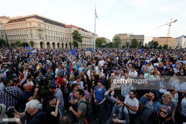 Prostesters gather at the parliament buliding in Budapest on May 21 as they take part in a demonstration against tough laws targeting foreignbacked...