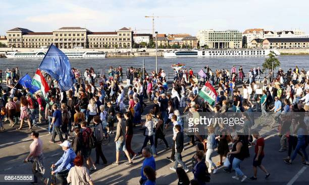 Prostesters march on May 21 in Budapest as they take part in a demonstration against tough laws targeting foreignbacked NGOs and higher education...