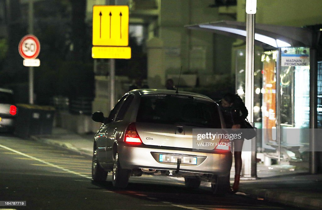 A prostitute speaks with a driver on March 28, 2013 in Nice, southern France. France's Senate will examine today a draft law aimed to abrogate the offense of soliciting clients. The bill should be adopted despite Socialist Party members dissenting on the issue.