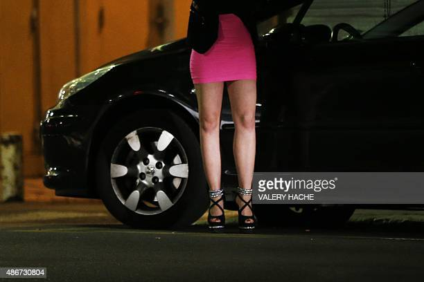 A prostitute waits for clients in a street of the French southeastern city of Nice on September 5 2015 AFP PHOTO / VALERY HACHE