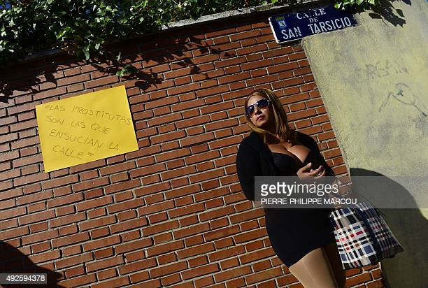 A prostitutes stands beside a hand written sign stuck on a wall during a protest performance called by AFEMTRAS a womens network of sex workers ' to...