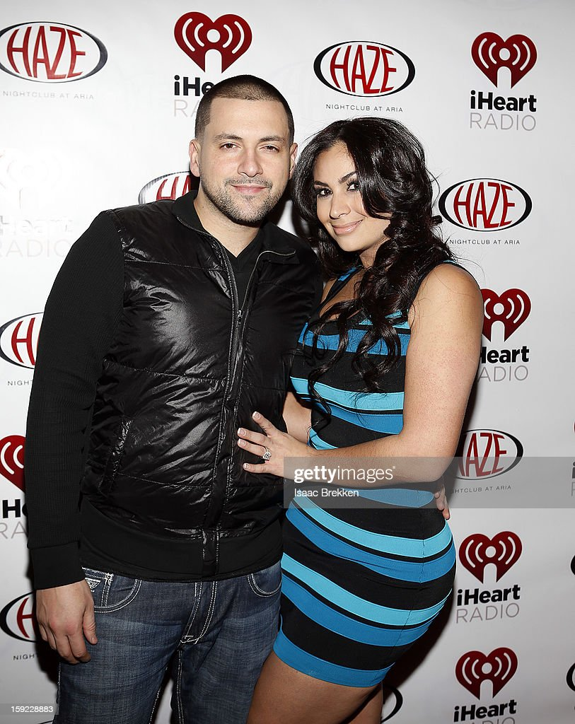DJ Prostyles (L) and Shreen Ayesh arrive at the iHeartRadio CES exclusive party featuring a live performance by Ke$ha at Haze Nightclub at the Aria Resort & Casino at CityCenter on January 9, 2013 in Las Vegas, Nevada.