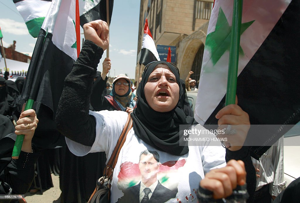 Pro-Syrian regime activists shout slogans during a march against the Israeli attacks on Syria as they rally outside the United Nations offices in the capital Sanaa, on May 7, 2013. Israeli air raids on Syria at the weekend killed at least 42 soldiers, a watchdog said, fuelling international concern over a spillover of the conflict, as Damascus warned it would strike back. AFP PHOTO/MOHAMMED HUWAIS