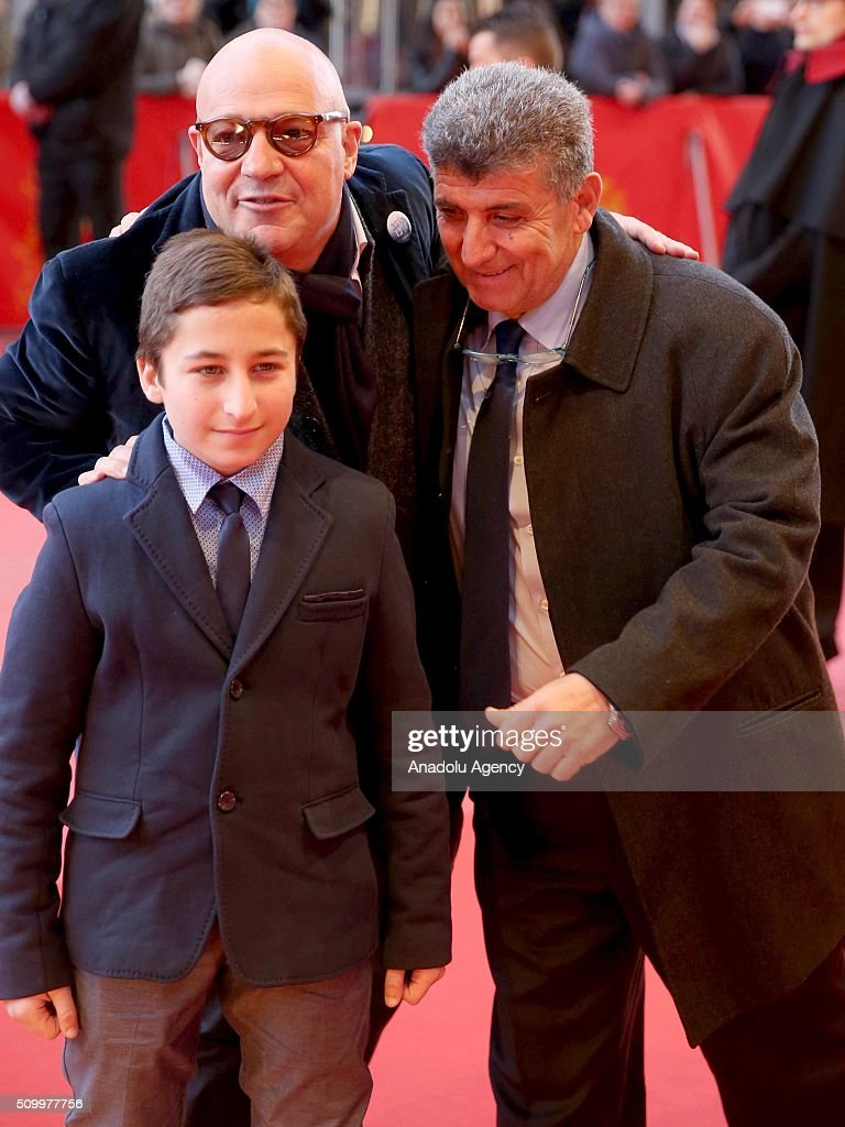 Protagonist Samuele Pucillo, director Gianfranco Rosi and protagnist Pietro Bartolo attend the 'Fire at Sea' (Fuocoammare) premiere during the 66th Berlinale International Film Festival Berlin at Berlinale Palace on February 13, 2016 in Berlin, Germany.