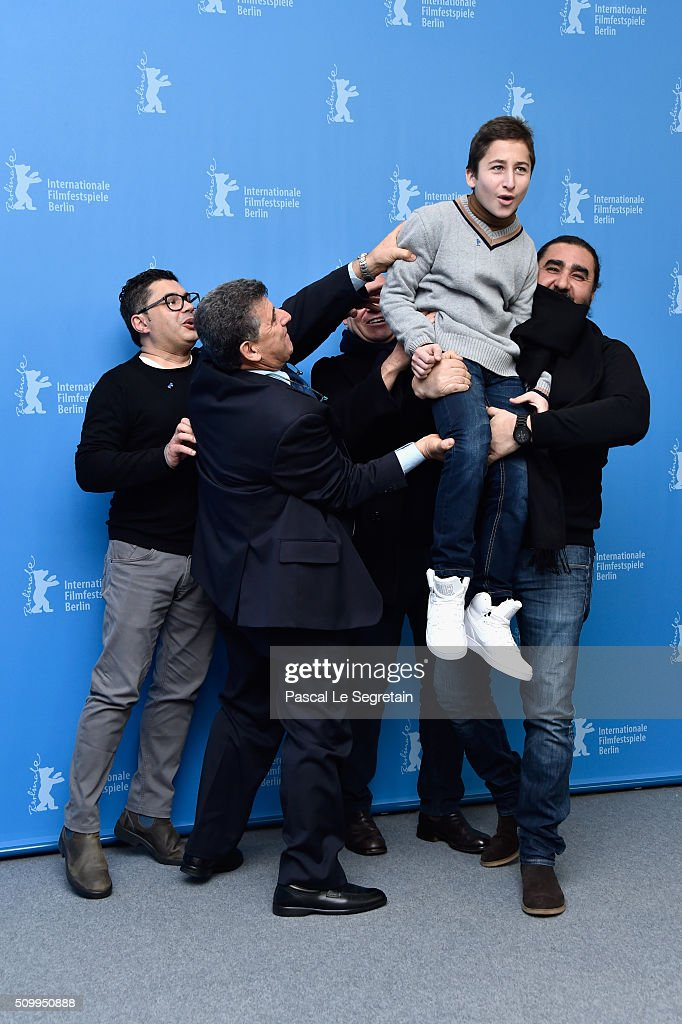 Protagonists Pietro Bartolo, (3rd L) Samuele Pucillo, director Gianfranco Rosi (C) attend the 'Fire at Sea' (Fuocoammare) photo call during the 66th Berlinale International Film Festival Berlin at Grand Hyatt Hotel on February 13, 2016 in Berlin, Germany.