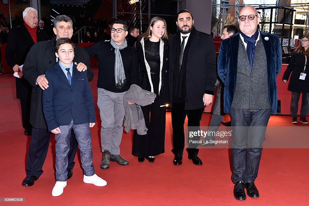 Protagonists Pietro Bartolo, Samuele Pucillo, guests and director Gianfranco Rosi (R) attend the 'Fire at Sea' (Fuocoammare) premiere during the 66th Berlinale International Film Festival Berlin at Berlinale Palace on February 13, 2016 in Berlin, Germany.