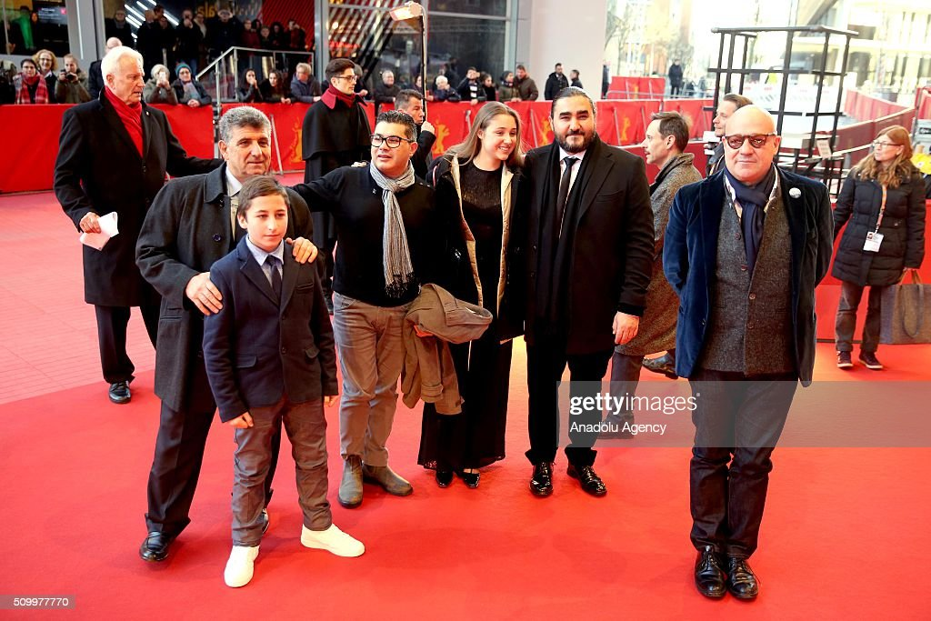 Protagonists Pietro Bartolo, Samuele Pucillo, Giuseppe Fragapane, guests and director Gianfranco Rosi (R) attend the 'Fire at Sea' (Fuocoammare) premiere during the 66th Berlinale International Film Festival Berlin at Berlinale Palace on February 13, 2016 in Berlin, Germany.