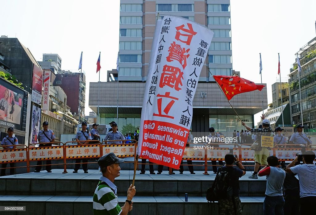 A proTaiwan independent activist displays a banner that reads 'Taiwan independent' outside the 2016 TaipeiShanghai Forum venue during the opening...