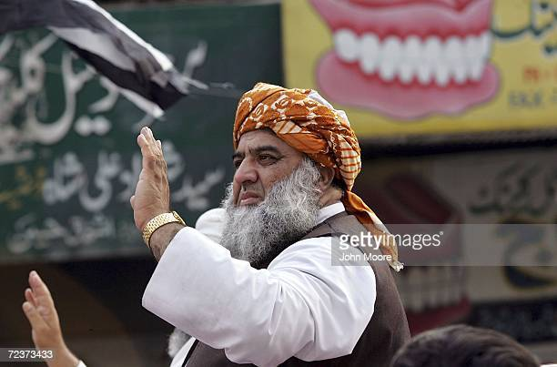 ProTaliban Pakistani opposition leader Maulana FazlurRehman greets supporters at an antiAmerican and antiMusharraf demonstration November 3 2006 in...