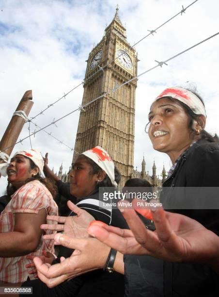 ProTamil protesters in a mockup Second World War concentration camp as the campaigners compared the plight in Sri Lanka to Nazi Germany in...