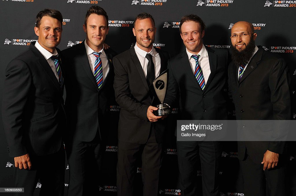 Proteas players Jaques Rudolph, Faf du Plessis, AB de Villiers, and <a gi-track='captionPersonalityLinkClicked' href=/galleries/search?phrase=Hashim+Amla&family=editorial&specificpeople=647392 ng-click='$event.stopPropagation()'>Hashim Amla</a> receive the Deloitte Outstanding Contribution to South African Sport Award from Paralympic Gold medallist <a gi-track='captionPersonalityLinkClicked' href=/galleries/search?phrase=Oscar+Pistorius&family=editorial&specificpeople=224406 ng-click='$event.stopPropagation()'>Oscar Pistorius</a> (C) during the Virgin Active Sport Industry Awards 2013 held at Emperors Palace on February 07, 2013 in Johannesburg, South Africa.