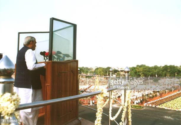 Protected By A Bulletproof Glass Screen Indian Prime Minister Atal Behari Vajpayee Addresses The Nation From The Ramparts Of The 17Th Century Red...