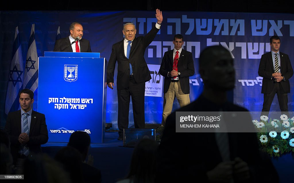 Protected by bodyguards, Israeli Prime Minister Benjamin Netanyahu (C) and ultra-nationalist Avigdor Lieberman (L) of the Likud-Beitenu list wave to supporters at the party headquarters in Tel Aviv early on January 23, 2013 after their Likud-Beitenu list won the Israeli general elections. Netanyahu said it was necessary to form the 'broadest possible government' after his Likud-Beitenu list won a narrow election victory, with the centrist Yesh Atid in second place.
