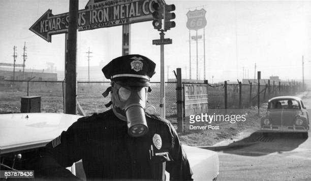 Protected From Gas Sgt CD Dressel wears mask for protection against chlorine gas which leaked from the SEC Corp plant 1801 W 14th Ave Wednesday...